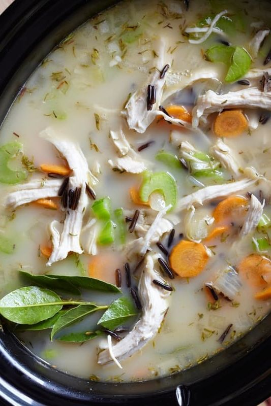 Simple and Easy Slow Cooker Chicken and Wild Rice Soup Recipe. If what you crave in fall soup recipes is pure comfort food with a side nostalgia, then you should get out your crockpot out now. For this dinner, you'll need shredded chicken (rotisserie works great), wild rice, thick-cut veggies, and a creamy broth, this easy soup nails cozy and comforting. A definite crowd pleaser of a meal!