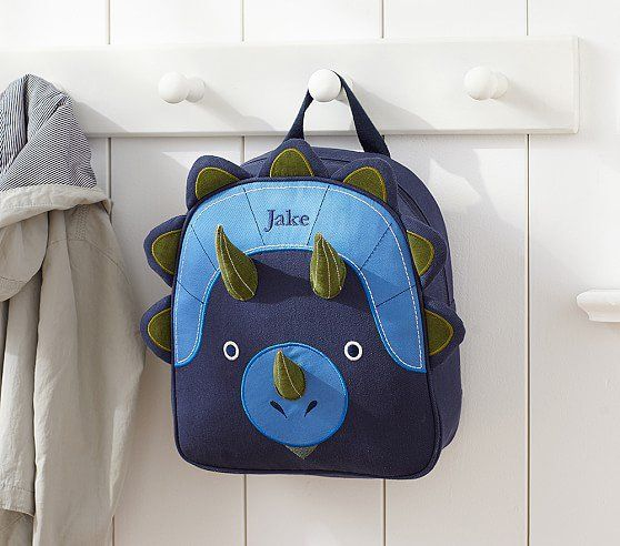 Pin for Later: Rawr! Your Little T-Rex Will Love These 24 Dinosaur School Bags and Lunchboxes Happy-saurus Pottery Barn Kids Preschool Dinosaur Backpack ($37)