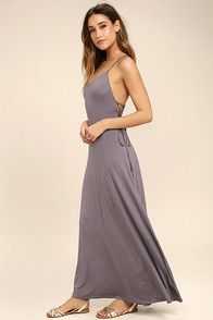 Your mood will instantly be lifted once the Mood and Melody Washed Blue High-Low Dress starts singing its song! Slinky stretch knit falls from twin spaghetti straps into a triangle bodice and cascading tulip skirt ending in a high-low hem. Crisscrossing straps at back.