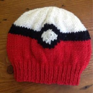 Gotta Catch 'Em All Pokemon Beanie - Ash wishes he had a hat like the Gotta Catch 'Em All Pokemon Beanie. Knitting patterns for kids have never been easier, or cooler, than this knit hat. This knit hat pattern shows you how to make a beanie using the stockinette stitch, which means it is a hat pattern you can use time and time again even if you don't want to wear a Pokeball on your head every day.