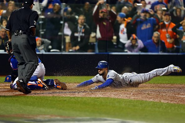 NEW YORK, NY - NOVEMBER 01: Eric Hosmer #35 of the Kansas City Royals scores a run off of a grounded out hit by Salvador Perez #13 to tie the game in the ninth inning against Jeurys Familia #27 of the New York Mets during Game Five of the 2015 World Series at Citi Field on November 1, 2015 in the Flushing neighborhood of the Queens borough of New York City. (Photo by Elsa/Getty Images)