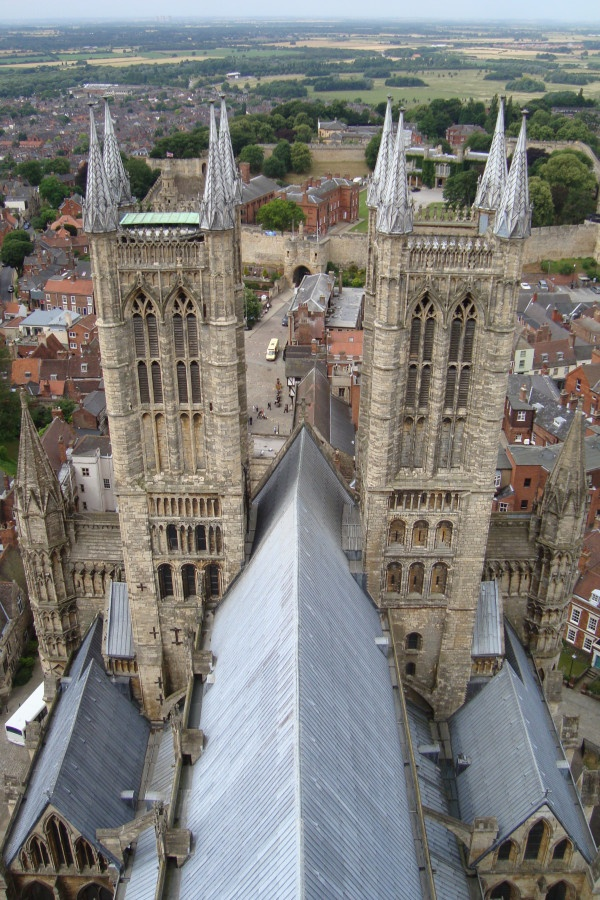 From the tower of Lincoln Catherdral, looking out over its Castle, you can see the castle entrance through the towers.