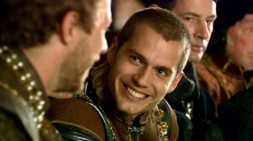 Henry Cavill as Charles Brandon in The Tudors. (Damn…what a gorgeous smile!)  And you'll notice Jeremy Northam in the background there, too. I miss Sir Thomas More.  (screencap credit: kelsrealm)
