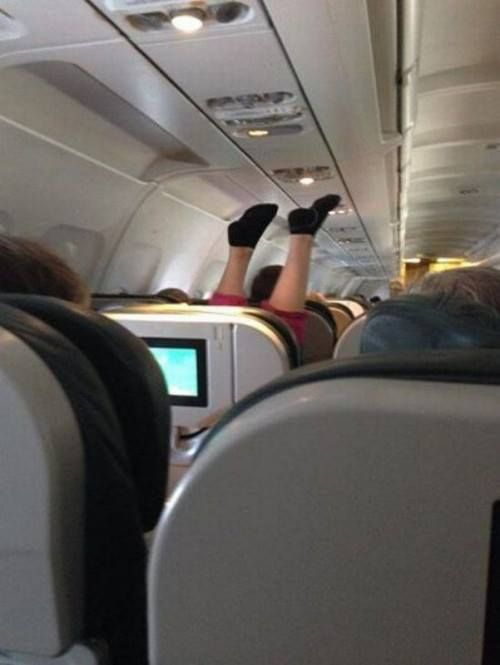 Only in USA. United Airlines. Airplane Yoga or drying wet smelly socks by the venting hose.