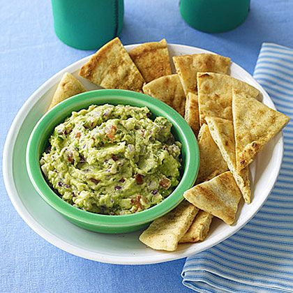 Guacamole with Cumin Chips | Learn how to make Guacamole with Cumin Chips. MyRecipes has 70,000+ tested recipes and videos to help you be a better cook