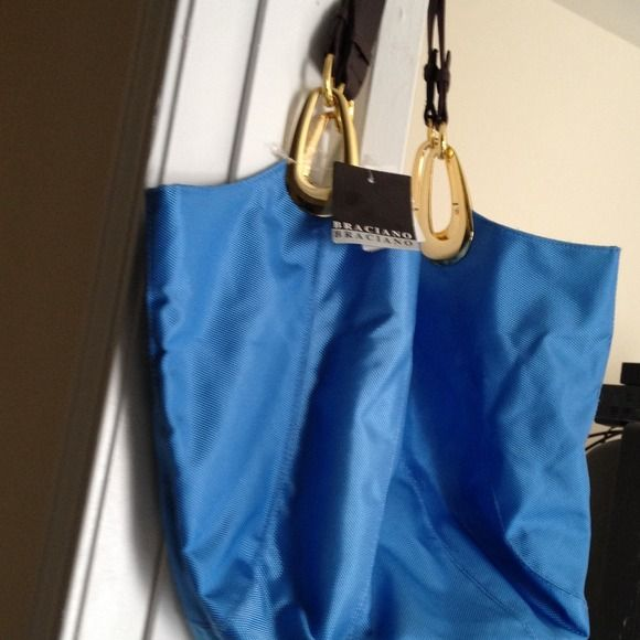 SKYBLUE HANDBAG(JUST REDUCED) NEW WITH TAGS POWDER BLUE PURSE WITH BROWN LEATHER STRAP AND GOLD HARDWARE . LARGE AND VERY ROOMY CANVAS . PURCHASED AT T. J.MAXX. DESIGNER:BRACIANO.......... Bags