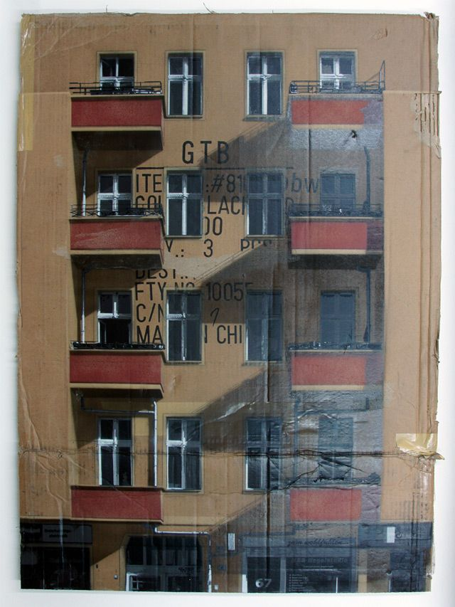 Artist EVOL paints city-scapes onto cardboard with spray paint