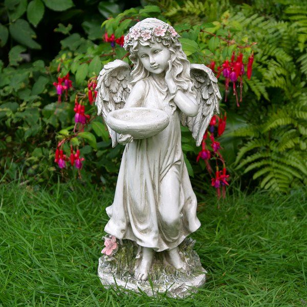 Flower Angel With Bowl. This delightful looking flower Angel is sure to light up your garden and is ideal as a small bird feeder / bird bath.