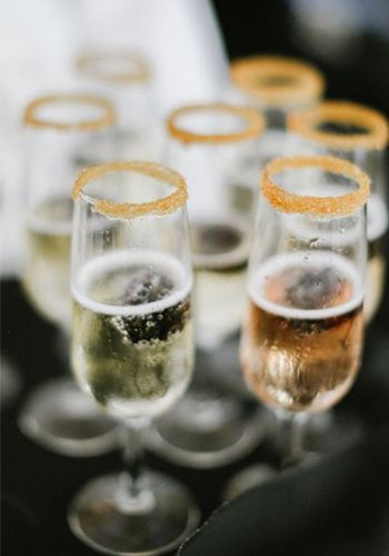 A gold sugar rim around passed champagne can add a festive touch to your winter wedding or holiday soiree | The William Aiken House in Charleston, South Carolina| Photo by Evan Laettner