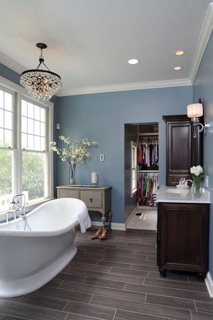 Mr dream bathroom - wood grain tile, chandelier, cozy blue walls, gorgeous soaker tub!