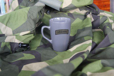 Our only grey color coffee mug with green black JÄGARE print! Note flash makes it look really light grey