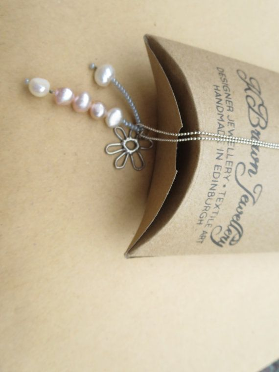 Check out this item in my Etsy shop https://www.etsy.com/uk/listing/154874285/pearl-pendant-necklace-flower-pendant