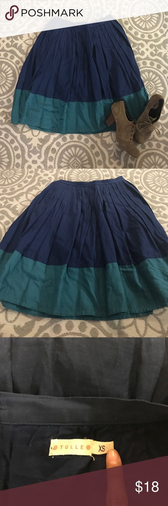 Navy pleated skirt with teal bottom trim