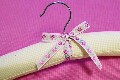 A tutorial with terrific instructions and photos telling how to make padded hangers.  She even suggests sewing a button on top and close to each end of the hanger to keep straps on.  Great idea!  I love this.