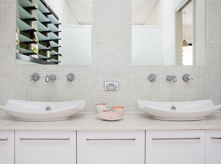 bathroom detail with glass mosaic tile splashback