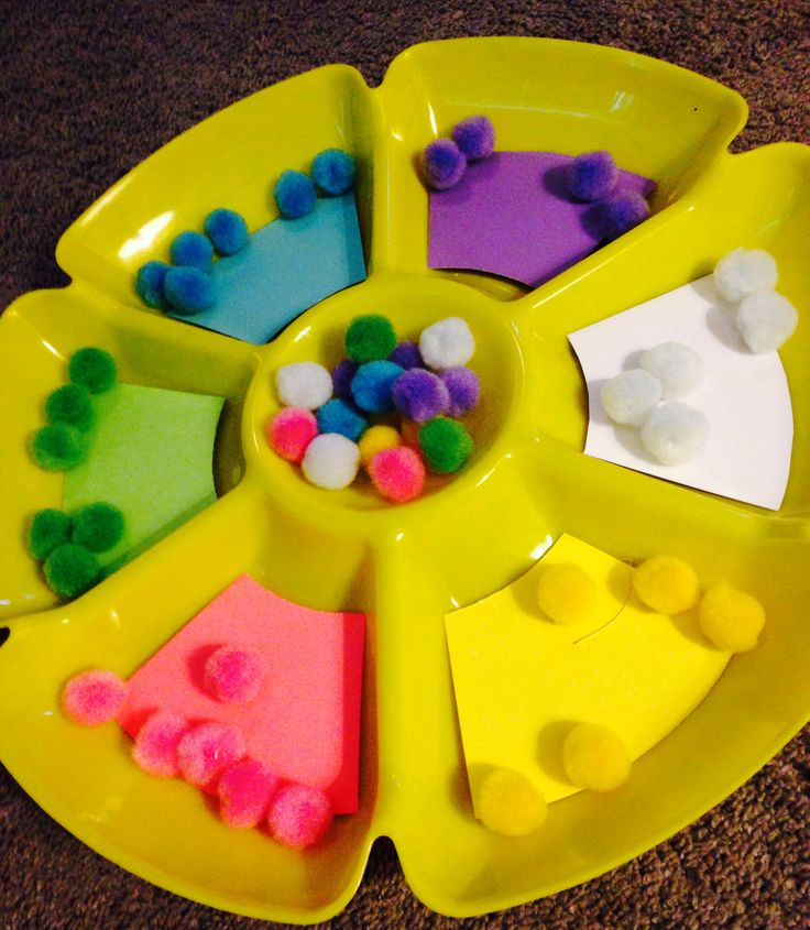 Cheap DIY color sorting game:  Sectioned veggie tray from Thrift Store- .99…
