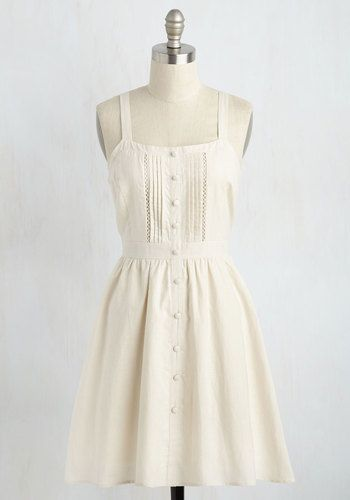 Shake up your weekend routine by hosting a romantic brunch in this pale beige sundress! Inspiring the depth of your savory pastries with its dimensional details, this cotton dress touts crisp pintucks, subtle gathering at the waistline, and a cascade of decorative buttons. A true feast for the eyes!