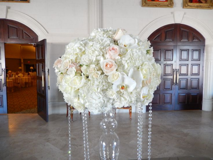 Receiving Table centre piece from Saturday's wedding at Bellvue Manor created by Dizennio Floral Boutique-Vaughan. Simple elegance with ivory hydrangeas, white Polar Star roses, blush Talia roses and Majolica spray roses.