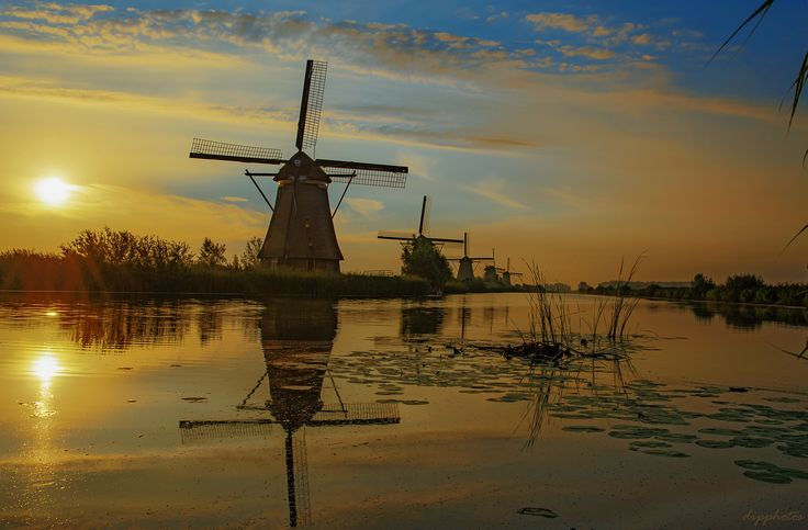 https://flic.kr/p/M1YYmj | Kinderdijk | The windmills of Kinderdijk.  Nineteen beautiful windmills, built around 1740, stand here as part of a larger water management system to prevent floods. Today, they symbolise Dutch water management, and in 1997 they were declared to be UNESCO World Heritage. Info. : www.holland.com/global/tourism/article/the-windmills-of-k...
