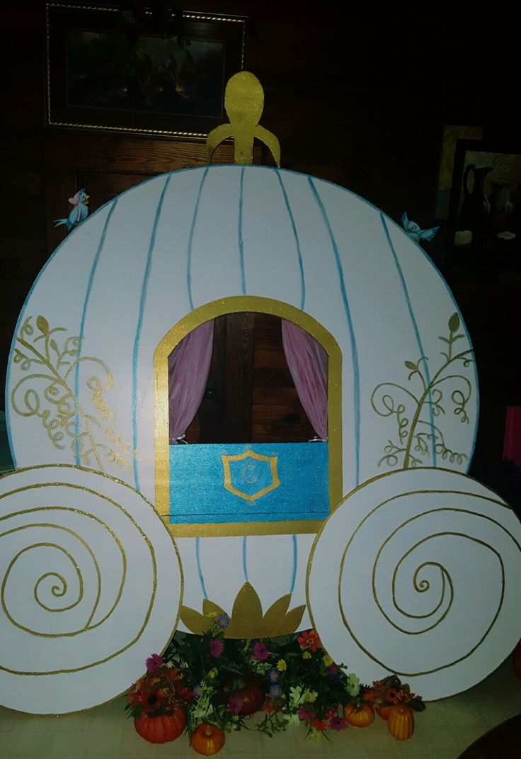 Cinderella carriage made for daughter's  6th birthday party. Made from foam insulation board bought from Lowes. Hand painted with acrylic paint. Tablecloth from Walmart used to make curtain. Printed on cardstock paper - bluebirds and mice from Cinderella movie.