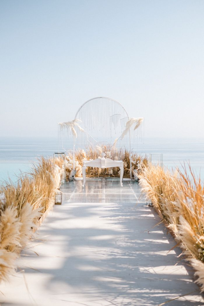 Natural Luxe Beach Inspired Bali Wedding At Alila Villas Uluwatu Junebug Weddings Beach Wedding Aisles Beautiful Beach Wedding Beach Theme Wedding