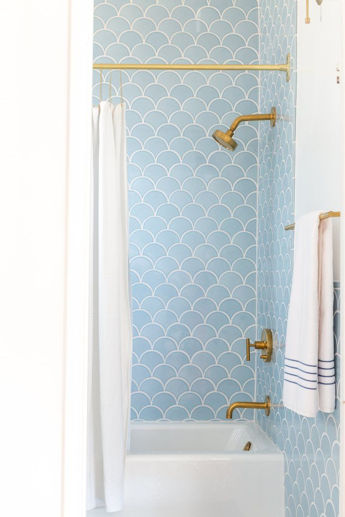 Blue Scallop Tile In A Bathroom With Gold Fixtures
