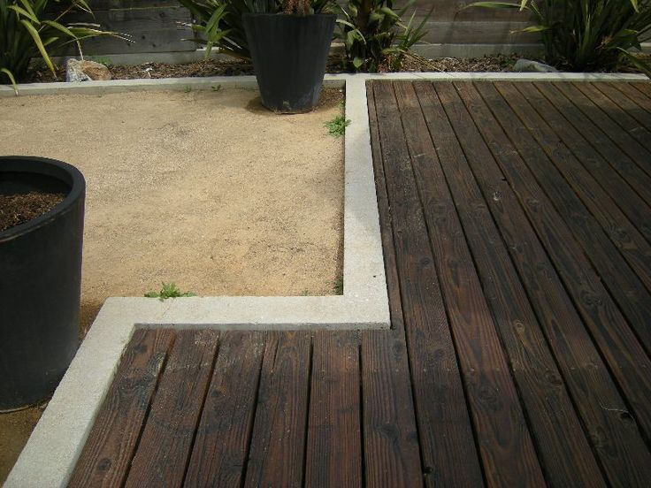Ground Level Deck In A Poured Concrete Curb.