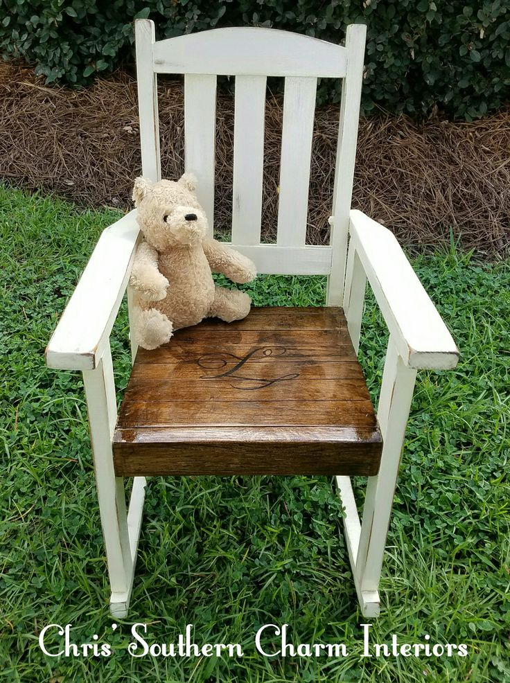 """Hand painted repurposed child's rocking chair in a cream with a dark stain for the seat. Has a hand painted custom """"L"""" on the seat"""