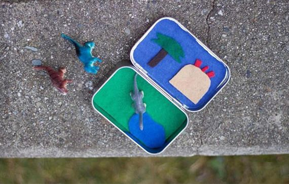 Our Dino busy box includes three. Plastic dinosaurs, and also has a volcano and palm tree as scenery. Your little one will love to pretend there in prehistoric times and build their imagination up playing with dinosaurs