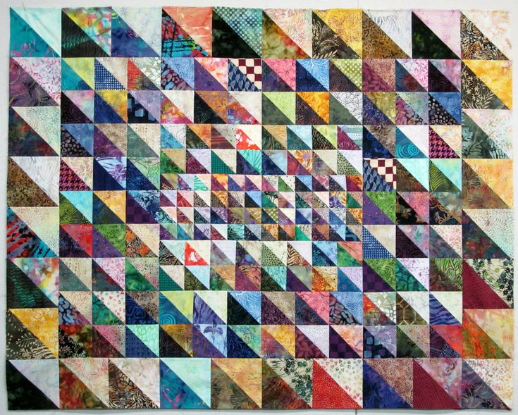 I had so much fun playing with many sizes of triangles to make this quilt top named Triangles #1