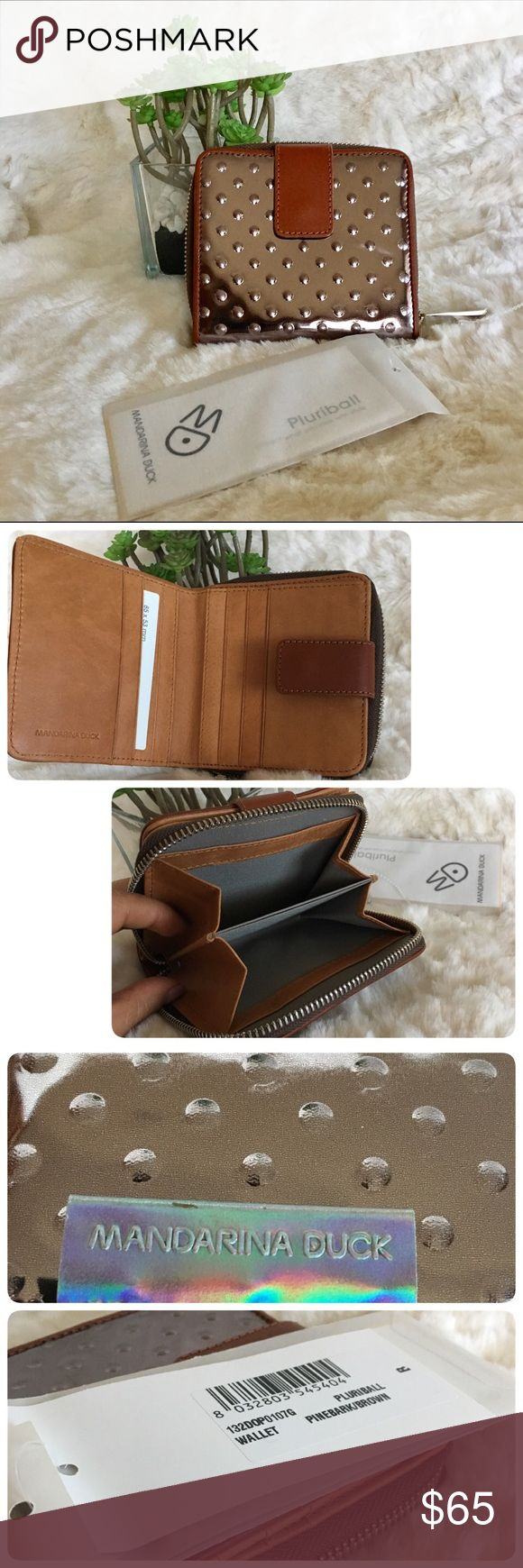 Mandarina Duck copper wallet pluriball made Italy Mandarina Duck Pluriball small wallet. Beautiful copper metallic tone, pine bark/brown color leather inside and gray lining. Made in Italy,new with tags. Mandarina Duck Bags Wallets