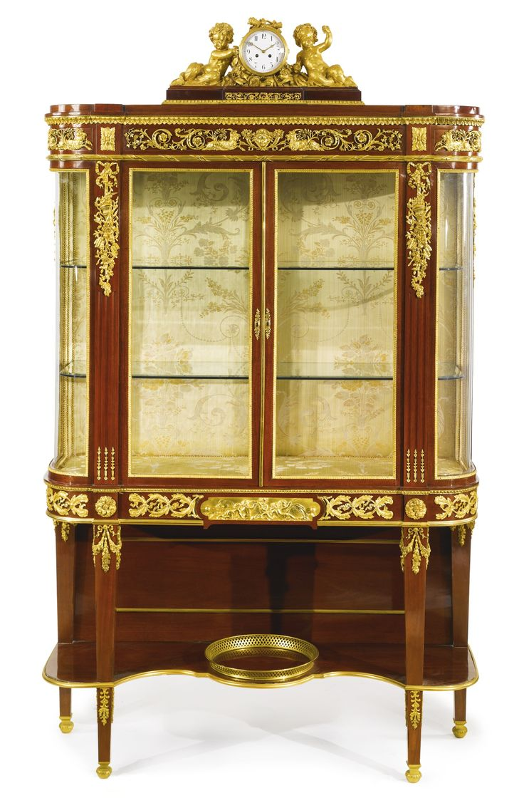 A LARGE AND FINE LOUIS XVI STYLE GILT BRONZE MOUNTED MAHOGANY VITRINE ON STAND France, early 20thcentury