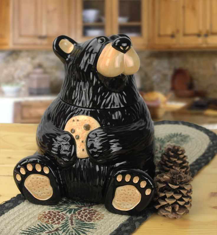 "The perfect bear to guard your sweet treats! This black bear cookie jar is hand-painted and made of ceramic materials. This is a great addition to any kitchen. Dimension: 9.25""""W x 11.5""""H  Made of ce"