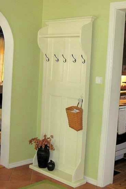 Use an old door to make a new coat rack