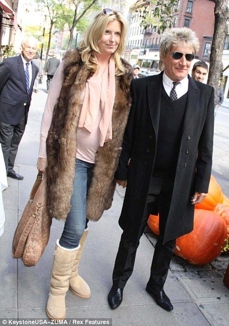 Mismatched: Rod Stewart dressed up in a sharply cut coat as Penny Lancaster went for comfort on a dinner date in New York yesterday