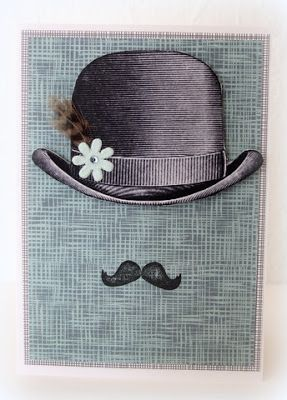 Bowler hat with feather, paper flower and stamped moustache_ Moski
