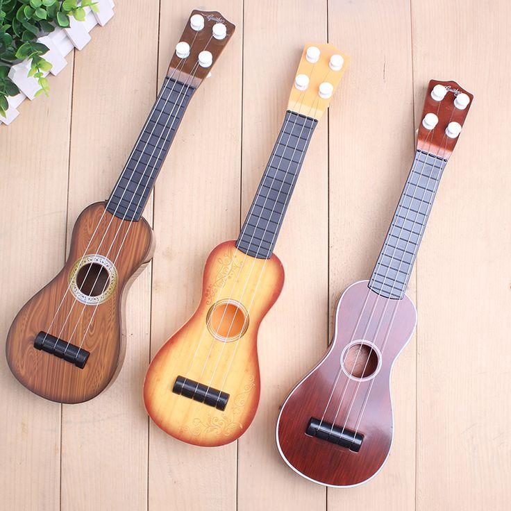 Les enfants apprennent Ukulélé Soprano Sapele 12 Ukulélé Guitare Hawaïenne Tauro TR-1S Petite Guitare Ukulélé Cordes Instruments de Musique