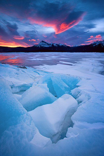 Frozen lake in Alberta and Chinook winds shaping the clouds, Canada