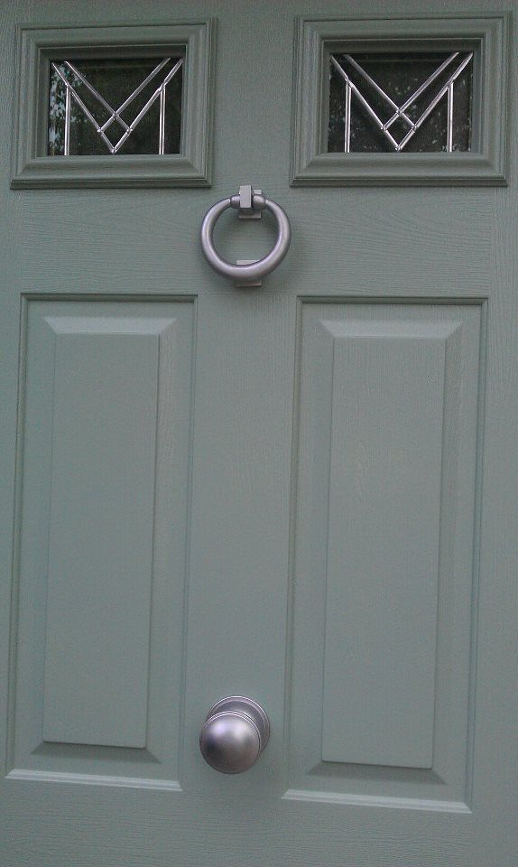 New Composite Door in heritage colour Chartwell green with satin chrome hardware. This is a Heritage colour revived by the National trust. It is a colour often seen on traditional cottages and houses in the beautiful Cotswold villages of England, U.K.