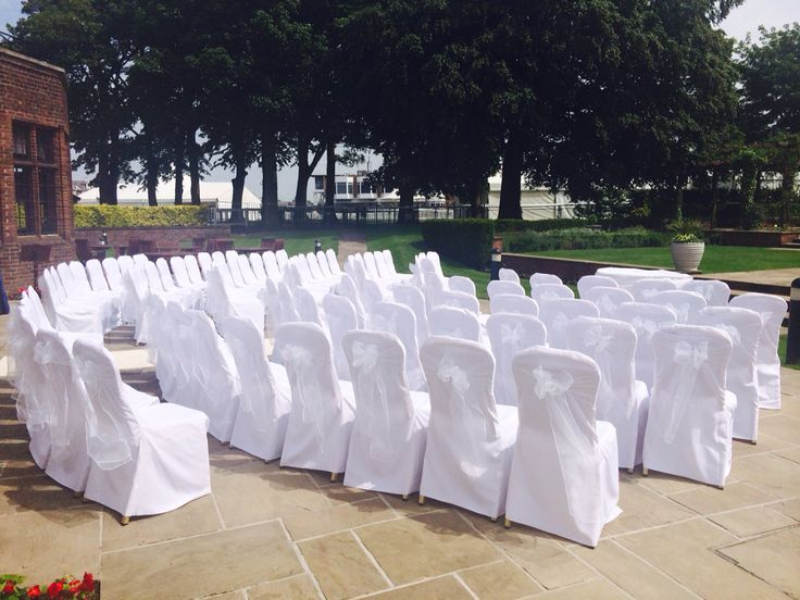 Crisp and fresh, white organza bows on white linen (polyester) covers, perfect for a outdoor ceremony  By Made Marvellous