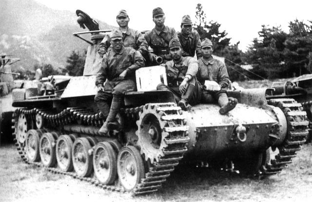 The Japanese crew of a Type 97 medium tank are photographed during the Battle of Battle of Changsha, part of the larger Japanese Operation Ichi-Go (Operation Number One.) Operation Ichi-Go was a campaign of a series of major battles between the Imperial Japanese Army forces and the National Revolutionary Army of the Republic of China.