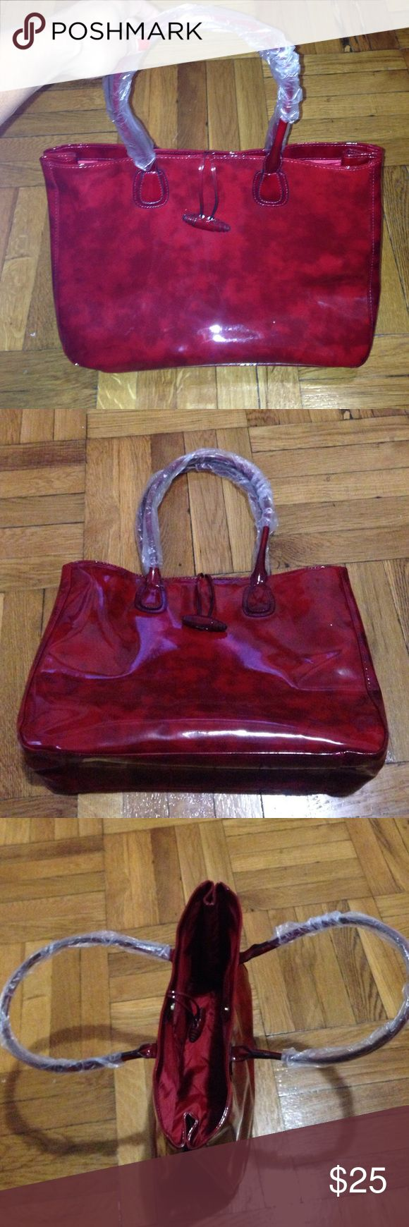 Elizabeth Arden red tote bag Elizabeth Arden red tote bag. Looks like patent leather material. It's big enough for a laptop. The perfect size bag for a woman in the go...can easily go from day to night. Elizabeth Arden Bags Totes