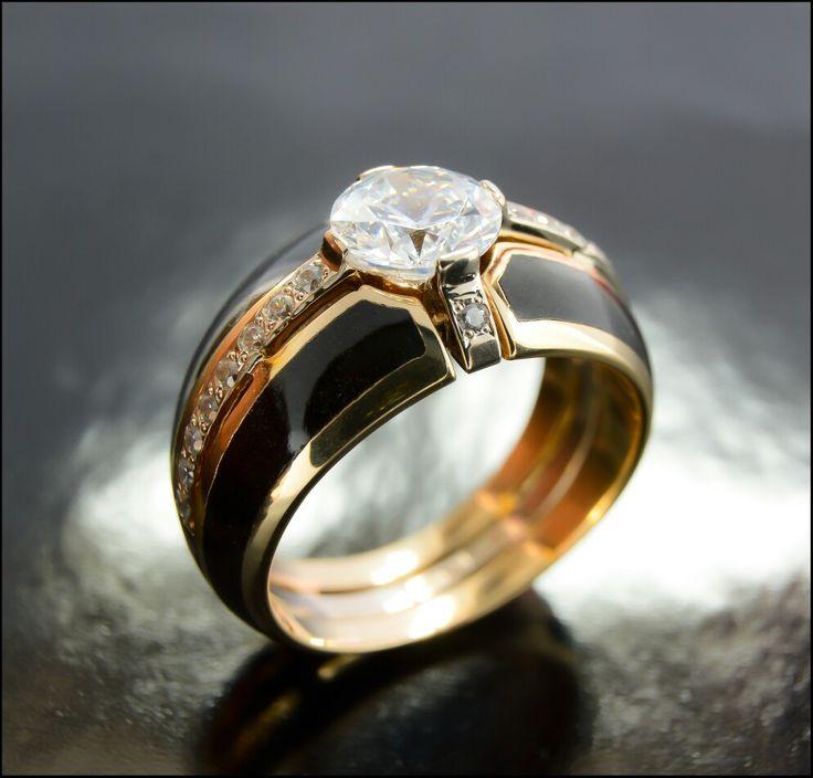 Gold , enamel, diamonds.