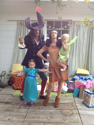 Peter Pan family costumes hook, tiger lily, tinkerbell, wendy, peter pan.... lol a little cheezy, but i like the idea ;)