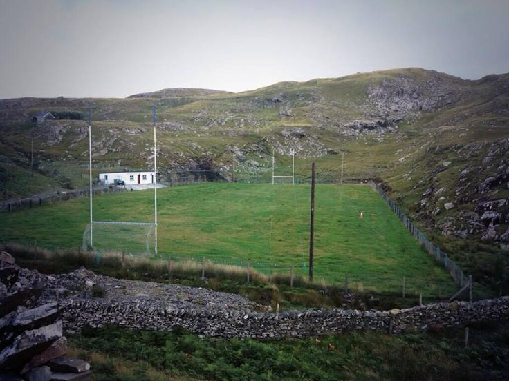 A GAA (Gaelic Football or Hurling) pitch on Inishturk Island off the coast of County Mayo, Ireland, surrounded by rugged, mountainous terrain [960x720]