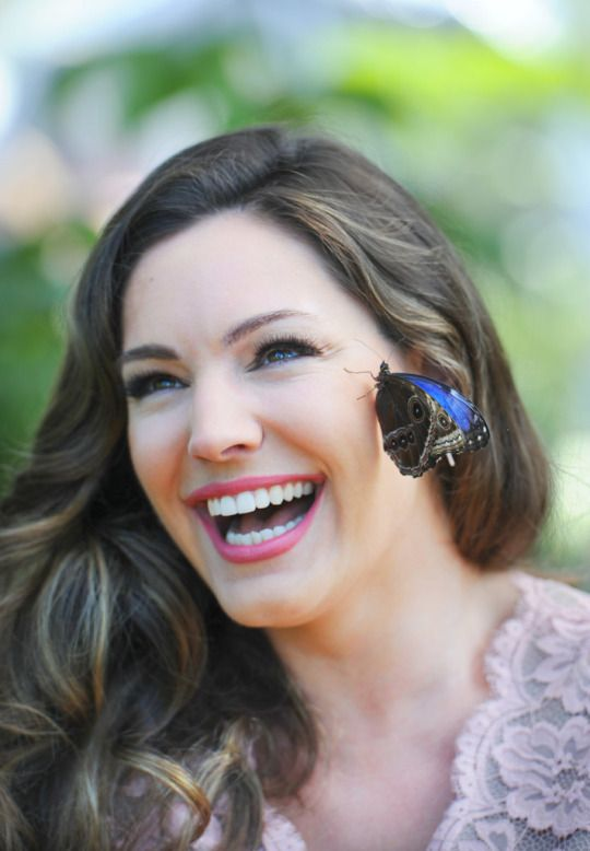 Kelly Brook poses with exotic butterflies during the launch of the RHS Hampton Court Flower Show at Hampton Court Palace on July 4, 2016 in London, England.