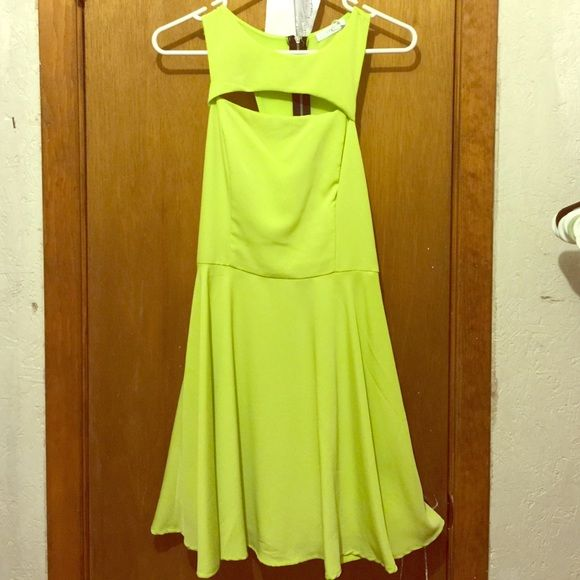 Neon green dress with cut out at chest Neon green dress. Has a cut out just above the chest, zipper back. NWT. Lush Dresses