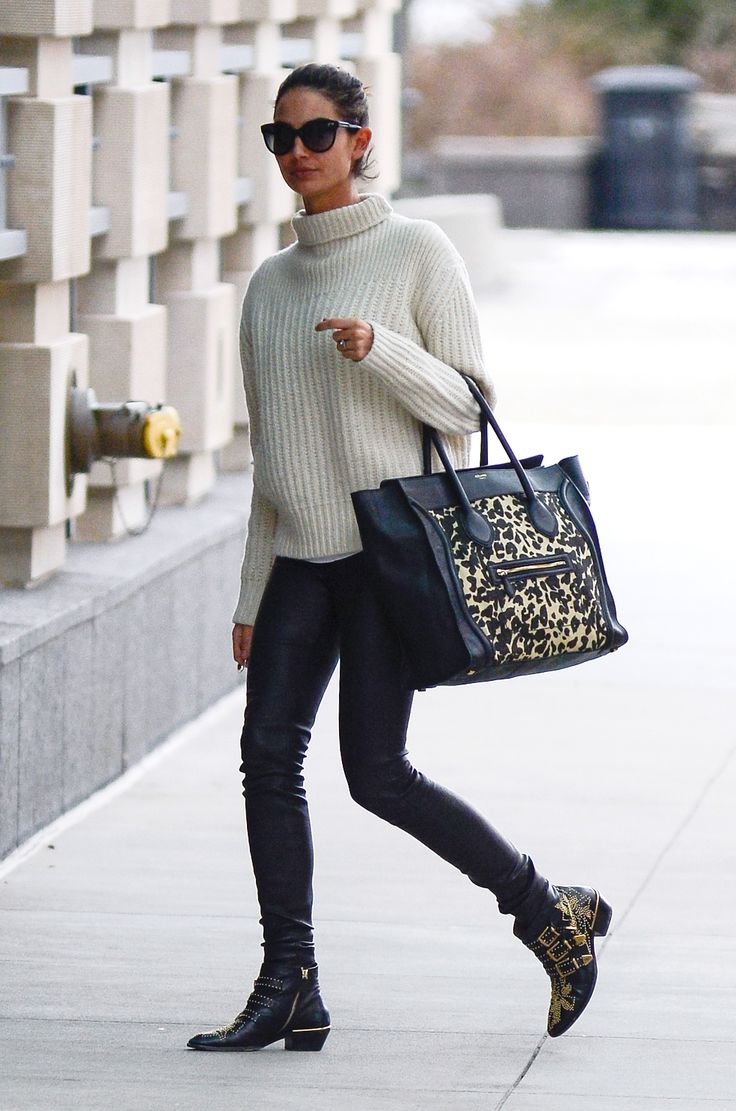 Pair a sweater with easy black pants and a carry-all for jet-setting style // Lily Aldridge