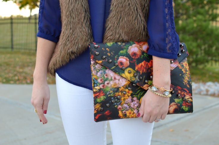 white jeans with a navy lace top, faux fur vest, and printed floral clutch | cute outfit ideas for the fall and winter | what to wear with a faux fur vest | fur vest outfit ideas | winter outfit ideas | layering ideas | a memory of us  | cute cluches |
