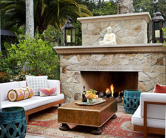 Tranquil Place A freestanding fireplace, featuring clean lines and a simple stone surround, adds warmth to this relaxing outdoor retreat. The fireplace's minimalist design is reminiscent of traditional Asian designs; this look is further emphasized by the structure of the furniture and the large Oriental area rug.